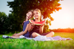 Cute girls eating watermelon Stock Image