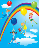 Cute girls flying away on balloons Royalty Free Stock Photography
