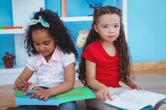 Cute girls holding books Stock Photography