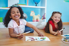 Cute girls painting letters royalty free stock photo