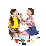 Cute girls play makeup Stock Photos