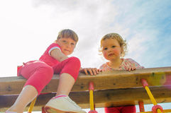 Cute girls at playground Royalty Free Stock Photos