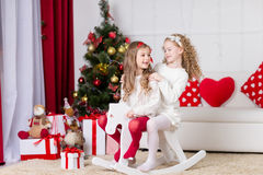 Cute girls playing  in Christmas decorated room Royalty Free Stock Photos