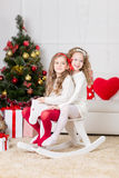 Cute girls playing  in Christmas decorated room Royalty Free Stock Photo