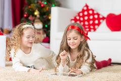 Cute girls playing  in Christmas decorated room Royalty Free Stock Images