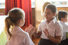 Cute girls playing clapping game Stock Photography