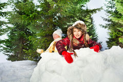 Cute girls playing the snowballs on a winter's day Royalty Free Stock Photo
