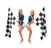 Cute girls posing with checkered flags at camera Stock Images