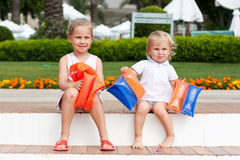 Cute girls preparing to go to swim in armbands. In the resort Royalty Free Stock Image