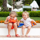 Cute girls preparing to go to swim in armbands Stock Photography