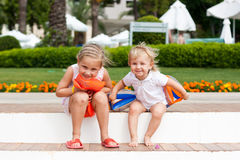 Cute girls preparing to go to swim in armbands Royalty Free Stock Photography