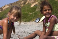 Cute girls in the sand Royalty Free Stock Photos