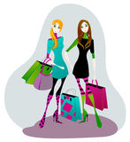 Cute girls with shopping bags Stock Photo