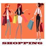 Cute girls with shopping bags Royalty Free Stock Image