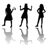 Cute girls silhouettes Stock Photos