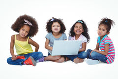 Cute girls sitting on the floor using laptop Royalty Free Stock Photo