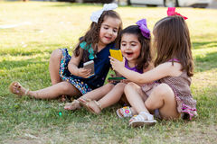 Cute girls social networking together Royalty Free Stock Photography