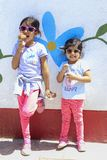 Cute girls with sunglasses eating a delicious ice cream royalty free stock photos
