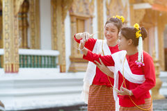 Cute girls in Thai tradition costume. Are dancing in temple with smiling face Royalty Free Stock Images
