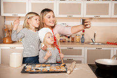 Cute girls and their mother making photo while Stock Photo
