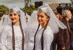 Cute girls in traditional white Georgian costumes ready for dancing performance in Georgia stock photo