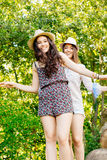 Cute girls walking on a tree trunk Royalty Free Stock Image