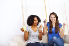 Cute girls watching TV Royalty Free Stock Photos