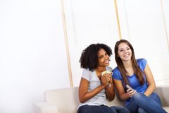 Cute girls watching TV Royalty Free Stock Photo