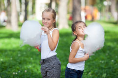 Cute girls with white cotton candy Royalty Free Stock Images