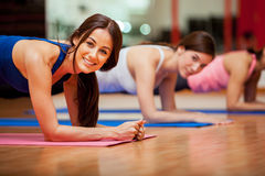 Cute girls working out in a gym Stock Photos