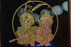 Cute glass ornament with gold filigree of young Sun Wukong,  the Stock Images