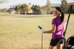 Cute golfer looking at the course Royalty Free Stock Photos