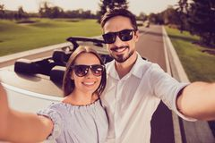 Cute gorgeous sweet partners with beaming grins taking photo on stock photography