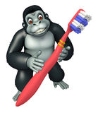 Cute Gorilla cartoon character with tooth brush Royalty Free Stock Image