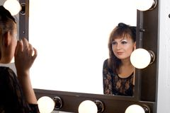 Cute gothic girl looking at herself Stock Image
