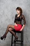 Cute gothic girl sitting on chair Stock Photo