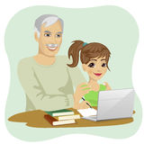 Cute granddaughter helping grandfather to use laptop Royalty Free Stock Photo