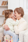 Cute grandmother is caring of small child Royalty Free Stock Image