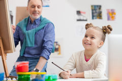 Cute grandparent and child are drawing with joy Stock Photography