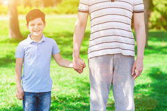 Cute grandparent and child are walking outdoors Stock Photo