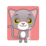 Cute gray cat holding a fish bone Royalty Free Stock Image