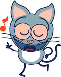 Cute gray cat singing and dancing enthusiastically Stock Photo