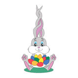 Cute gray Easter rabbit with long ears holds a plate with colorf Royalty Free Stock Photos
