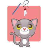 Cute gray kitten eager to play. With toy Royalty Free Stock Photos