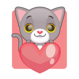 Cute gray kitten holding a giant heart Royalty Free Stock Photography