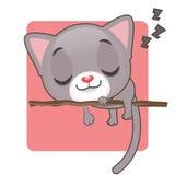 Cute gray kitten sleeping. On a branch Stock Image