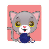 Cute gray kitten with their blue yarn ball Stock Photo