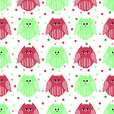 Cute green and carmine owls with dots in the background. Vector seamless pattern of cute green and carmine owls with dots in the background Stock Photo