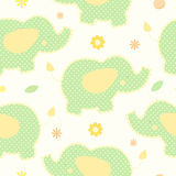 Cute green elephant seamless vector background. Patchwork style. Leaves and flowers around Royalty Free Stock Images