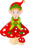 Cute green elf sitting on mushroom Stock Images